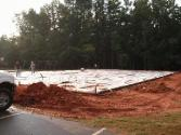 Getting ready to pour cement on new gym